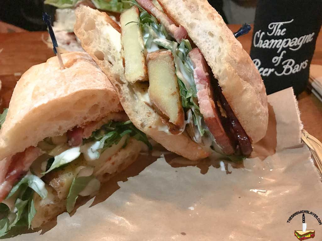 Thick cut bacon and rosemary sweet potato with goat cheese vinaigrette, arugula, and aioli on ciabatta