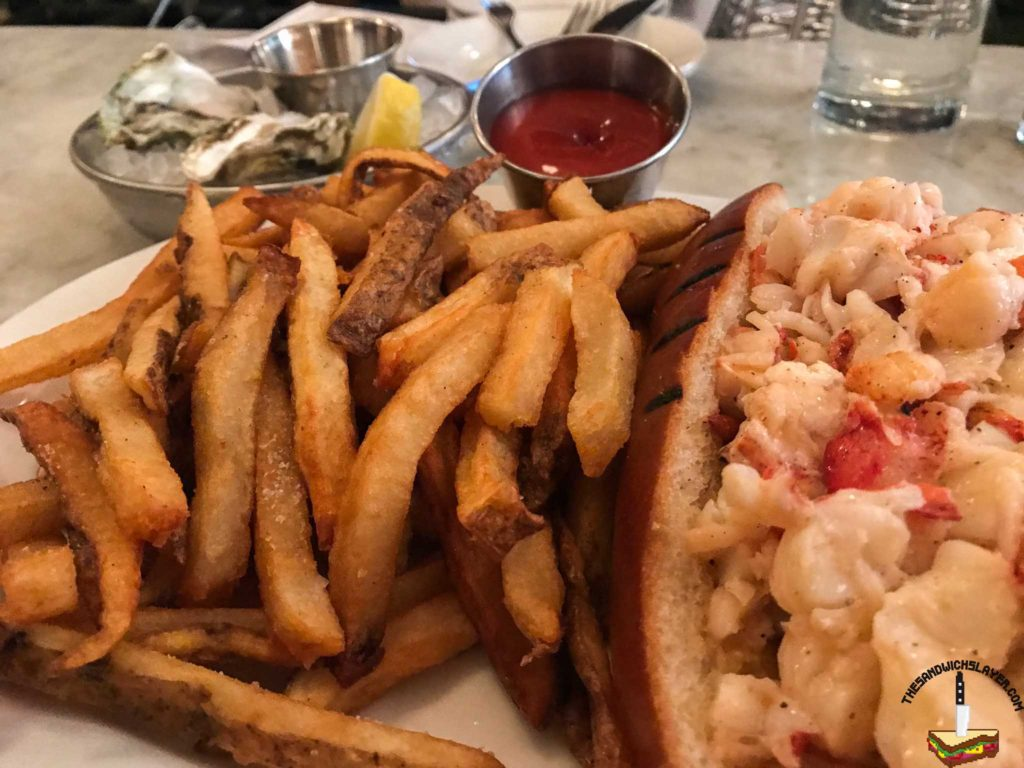 Neptune Oyster Hot lobster roll with mleted butter