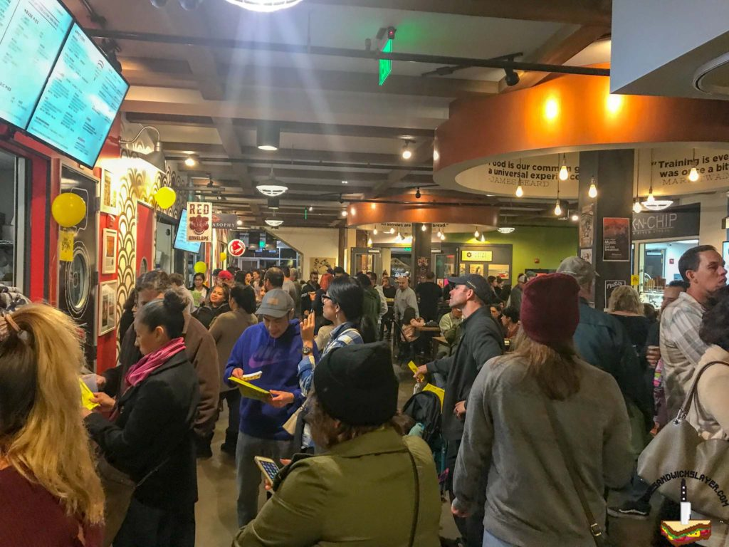 The crowded hall of the 4th street market during Savor Santa Ana